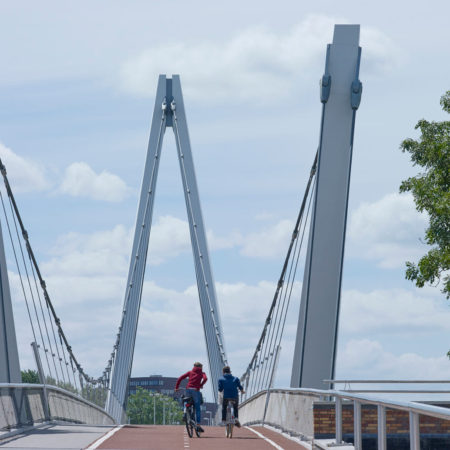 The-braided-cables-of-the-bridge-create-a-slender-archway-to-the-new-town