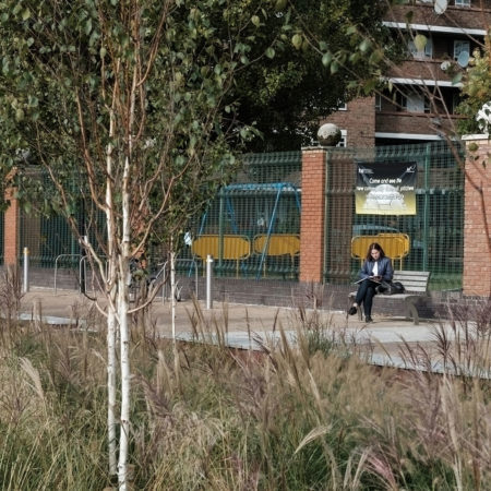 39-RBA-Bridget-Joyce-Square,-Australia-Road-person-resting