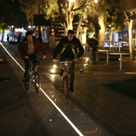 09-HAMAMYOLU URBAN DECK-bicycle riders finding their way on led light beam axis