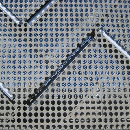 11_Detail-of-perforated-plaque-showing-slits-for-LED-bars