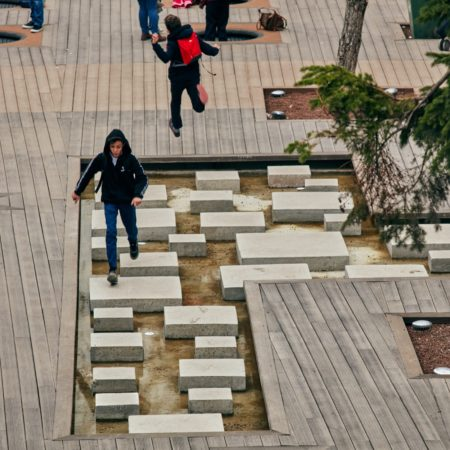 17-HAMAMYOLU URBAN DECK-young people crossing the stone pool by ricocheting