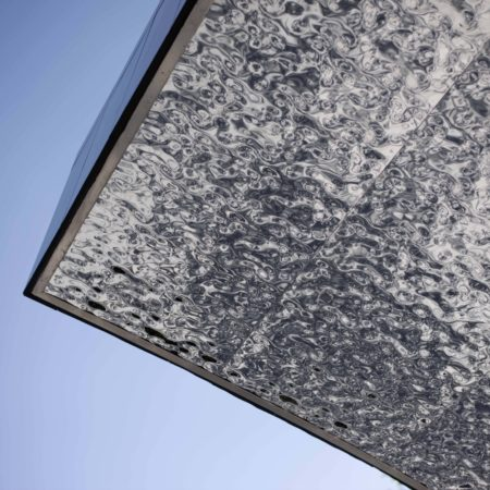 Under the waterfall, the top surface simulates water ripples through the corrugated stainless steel
