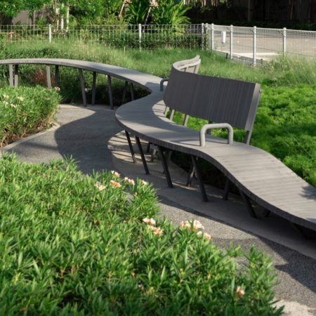 Outdoor exposed seatings among plantings