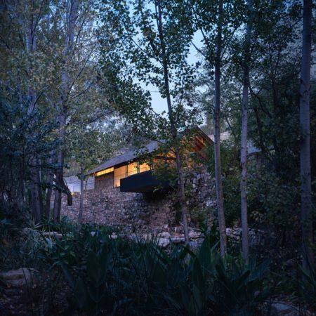 02 restaurant hidden in the woods The building blends into the original terrain and woods ©zystudio